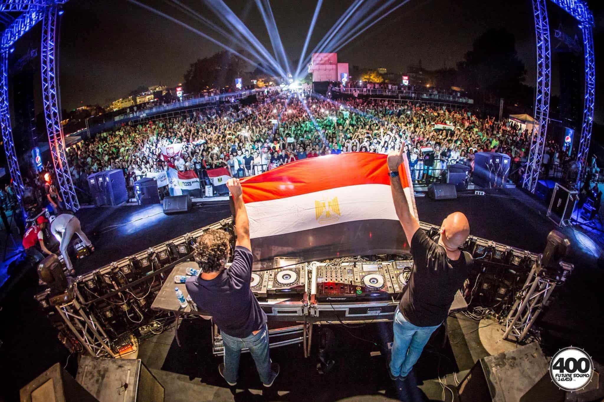 Aly & Fila holding the Egyptian flag